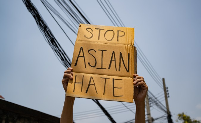 "Person holding a ""Stop Asian Hate"" sign"
