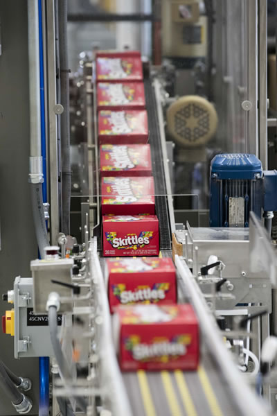 Skittles® boxes on a Mars, Incorporated factory production line.